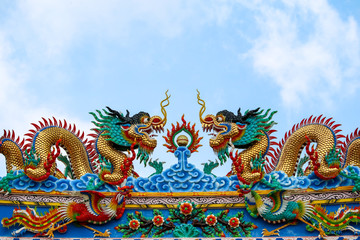 double dragon on roof of chinese temple gate and blue cloud Wall mural