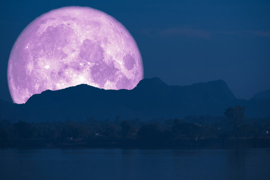 super full fish moon back on cloud and mountain on night sky