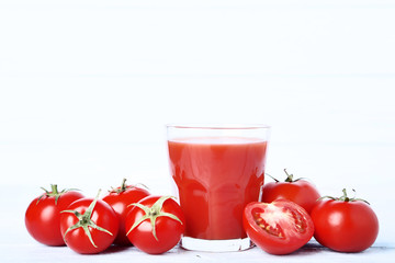 Wall Mural - Tomato juice in glass on wooden table