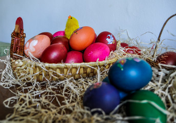 Colorful Easter eggs decorated in a basket for holiday
