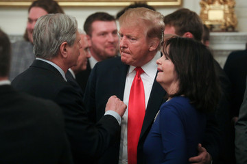 U.S. President Trump speaks with Senator Hoeven and wife after White House reception for North Dakota State Bison in Washington
