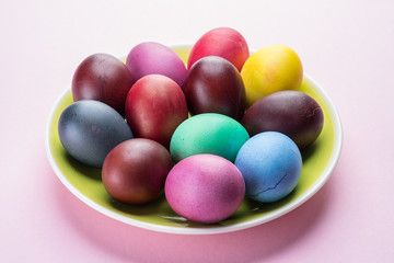 Colorful Easter eggs as an attribute of Easter celebration. Pink background.