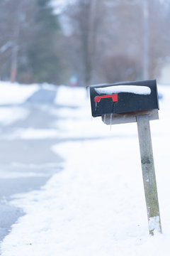 Winter mail boxes in the snow with shallow depth of field