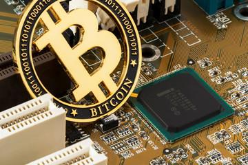 Bitcoin on a computer board. Internet finance. High technology