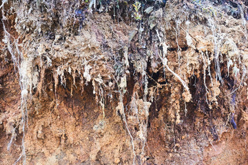 Background layers of soil and rock that was eroded and drilling until a cliff