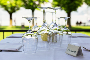Empty wine glasses stand on a table in a restaurant