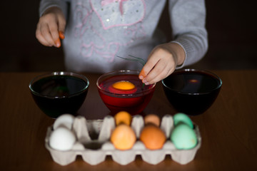 Happy easter. Little girl painter painted eggs. Kid preparing for Easter. Painted hand. Art and craft concept. Traditional spring holiday food