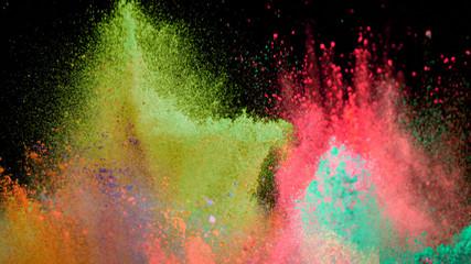 Multi-color powder explosion on black background