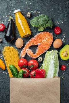 Supermarket. Paper bag full of healthy food.