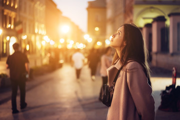 Beautiful girl in the evening on the street