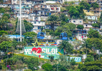 Cityview of Siloé with telespheric public transportation, Cali, Colombia