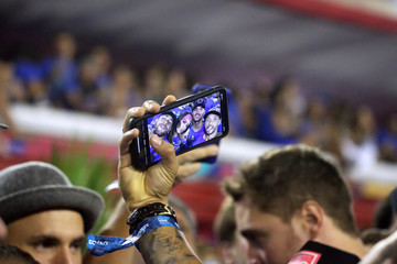 Brazilian soccer player Neymar takes a selfie photo with Brazilian pro surfer Gabriel Medina, Brazilian singer Anita and Brazilian soccer player Nene during the second night of the Carnival parade at the Sambadrome in Rio de Janeiro