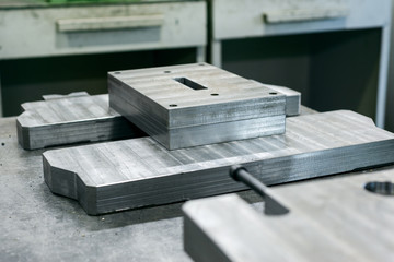 Straight row of metal bars after grinding.