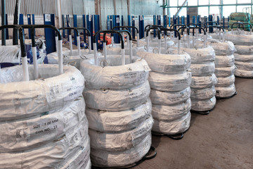 Industrial warehouse of cold rolled wire. The wire coils are stacked off the stack