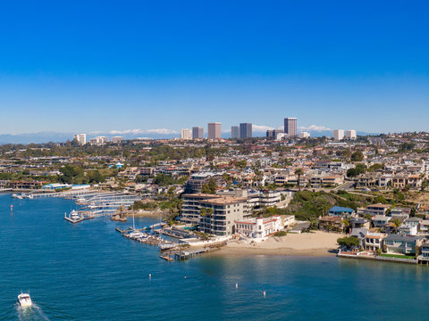 Aerial drone shot of Newport Beach harbor in Orange County California on a sunny day.
