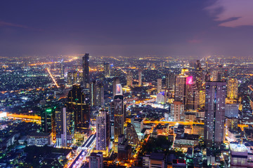 high view of city in night time with lighting