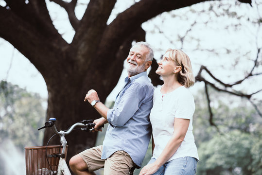 Lifestyle senior couple happy and relaxed . Good Healthy elderly in park nature. Group of Senior Retirement dancing, relaxtion, enjoy vacation summer
