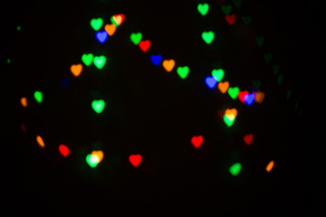 Colorful abstract heart shape blured bokeh at night