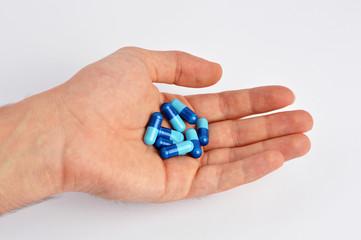 Hand holding capsules