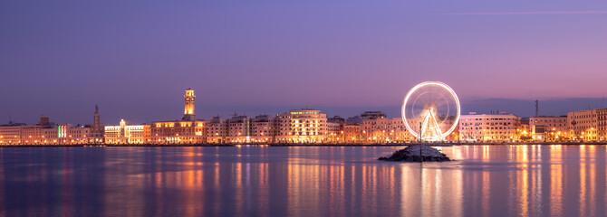 Night view of Illuminated giant Ferris wheel on the waterfront of Bari, region of Apulia, Italy. Puglia