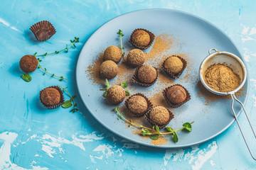 Cocoa balls, handmade chocolate balls cakes in a blue tray
