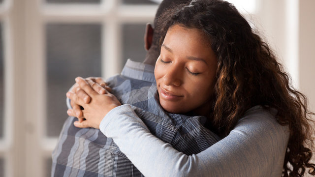 Loving girlfriend hug boyfriend happy to reconcile after fight