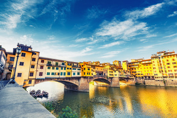 Scenic view on Ponte Vecchio in Florence, Italy, on a summer day. Colorful travel background.