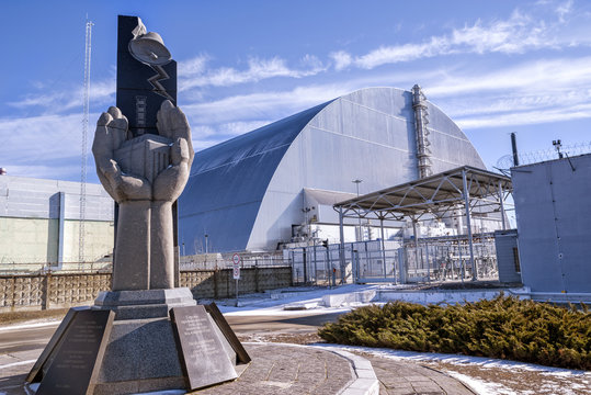 Monument, fourth reactor and its enclosing sarcophagus in Chernobyl Exclusion Zone, Ukraine