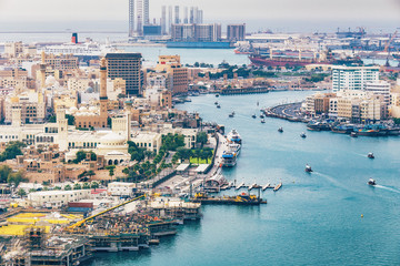 Aerial daytime skyline of Dubai, UAE. View on harbor in the distance. Scenic travel background.