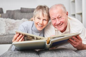 Senior couple with photo album