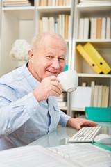 Senior businessman in a coffee break