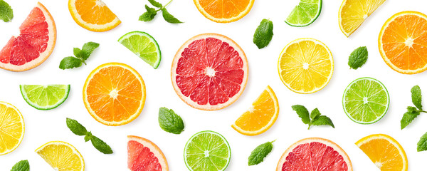 Colorful pattern of citrus fruit slices and mint leaves