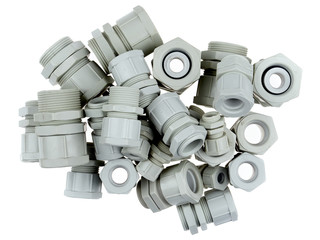 A group of plastic cable glands isolated on white background