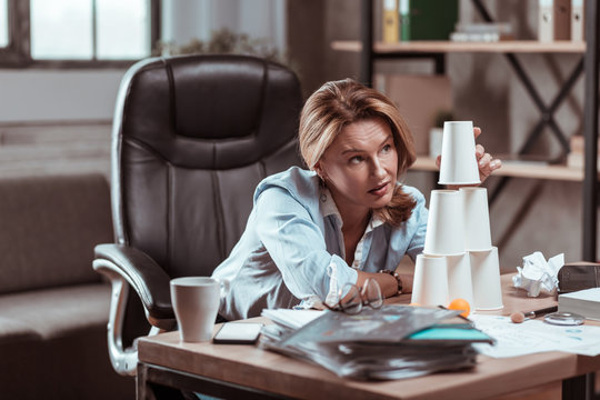 Blonde lawyer having no inspiration feeling stressed and depressed