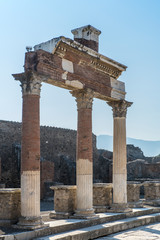 POMPEII, ITALY - 8 August 2015: Ruins of antique roman temple in Pompeii near volcano Vesuvius, Naples, Italy
