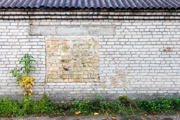 Old wall with bricked up window
