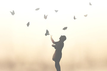 surreal moment of a woman dancing with butterflies