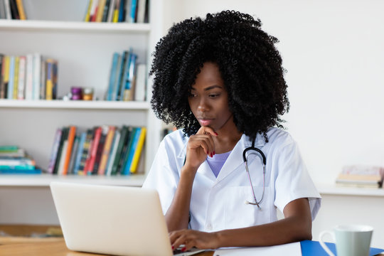 African american medical student learning at computer