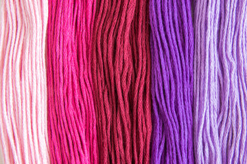Sewing threads in different colors abstract.
