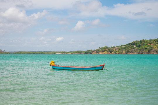 Small boat at Pontal da Ilha beach, at the north tip of Itamaraca island (Pernambuco, Brazil)
