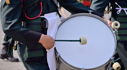 Close-up of Bagpiper playing drum