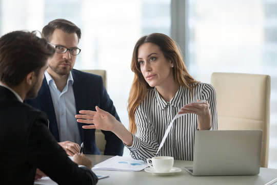 Dissatisfied executive having conflict with employee about financial report mistake