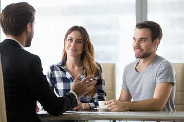 Financial advisor making presentation offer to clients at meeting