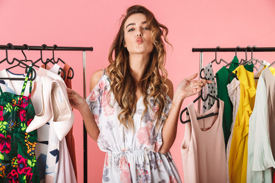 Photo of trendy woman near wardrobe with clothes choosing what to wear