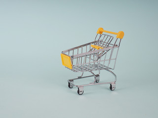 empty shopping carts on blue background, copy space