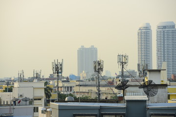 Wireless Communication Antenna With bright sky.Telecommunication tower with antennas with blue sky.