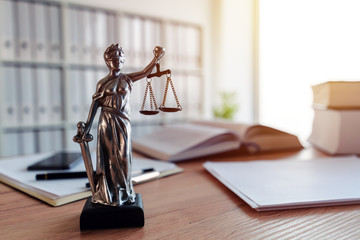 Lady Justice statue in law firm office