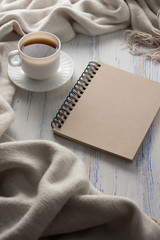 Cup with Coffee, Notepad on the White Wooden Table. Concept of Spring