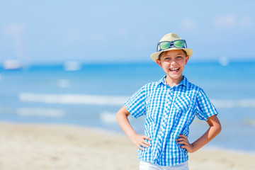 Portrait of Adorable boy playing on the beach.
