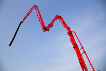 High arms of crane in building site